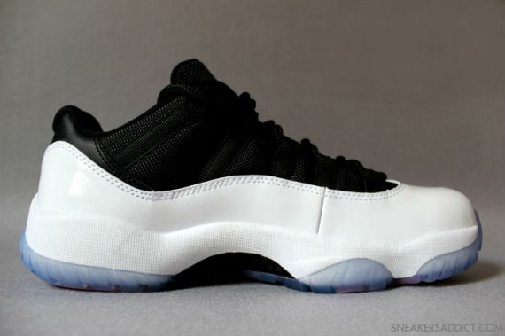 air-jordan-xi-retro-low-white-black-red-3-570x379