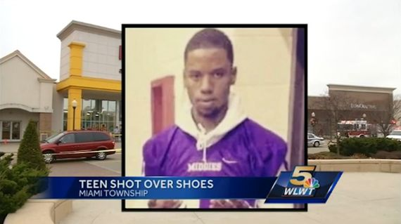 teen shot over jordan XI legend blue_result