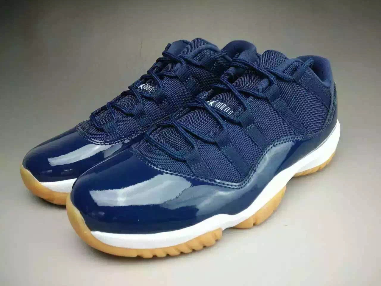 air-jordan-11-low-midnight-navy-gum-01