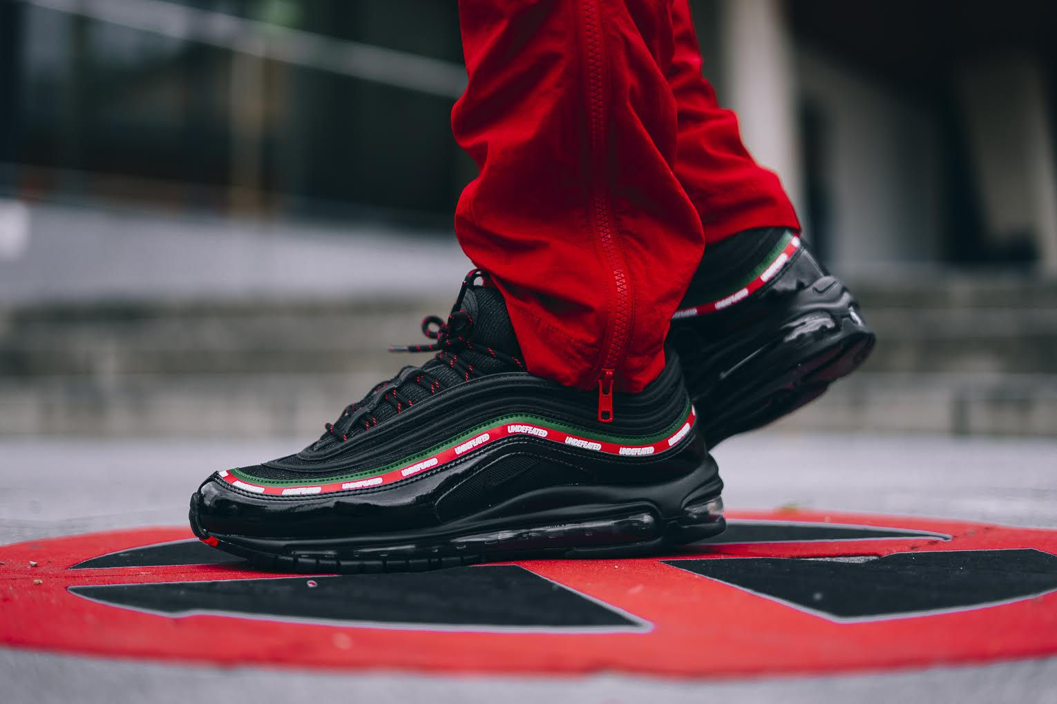 sports shoes f9f93 a1ee0 Seen here is the Nike Air Max 97 x Undefeated collaboration that features a  black, gorge green, white and speed red ...