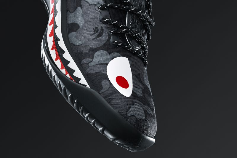 3e0812962cfb9 ... A Bathing Ape, to recreate the signature Dame 4 basketball shoe in  three new colorways – green black and red. Using BAPE's trademark Shark  tooth design ...